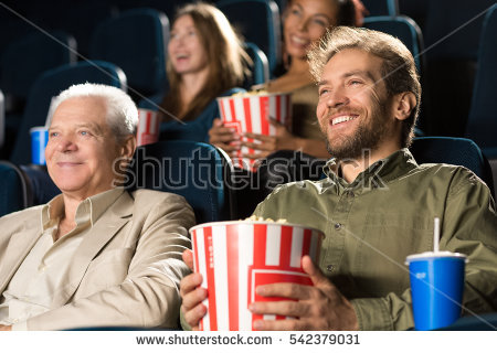 stock-photo-father-and-son-time-low-angle-shot-of-a-cheerful-mature-man-laughing-enjoying-a-movie-together-542379031